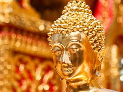Gold face of Buddha statue in Doi Suthep temple, Chiang Mai, Thailand